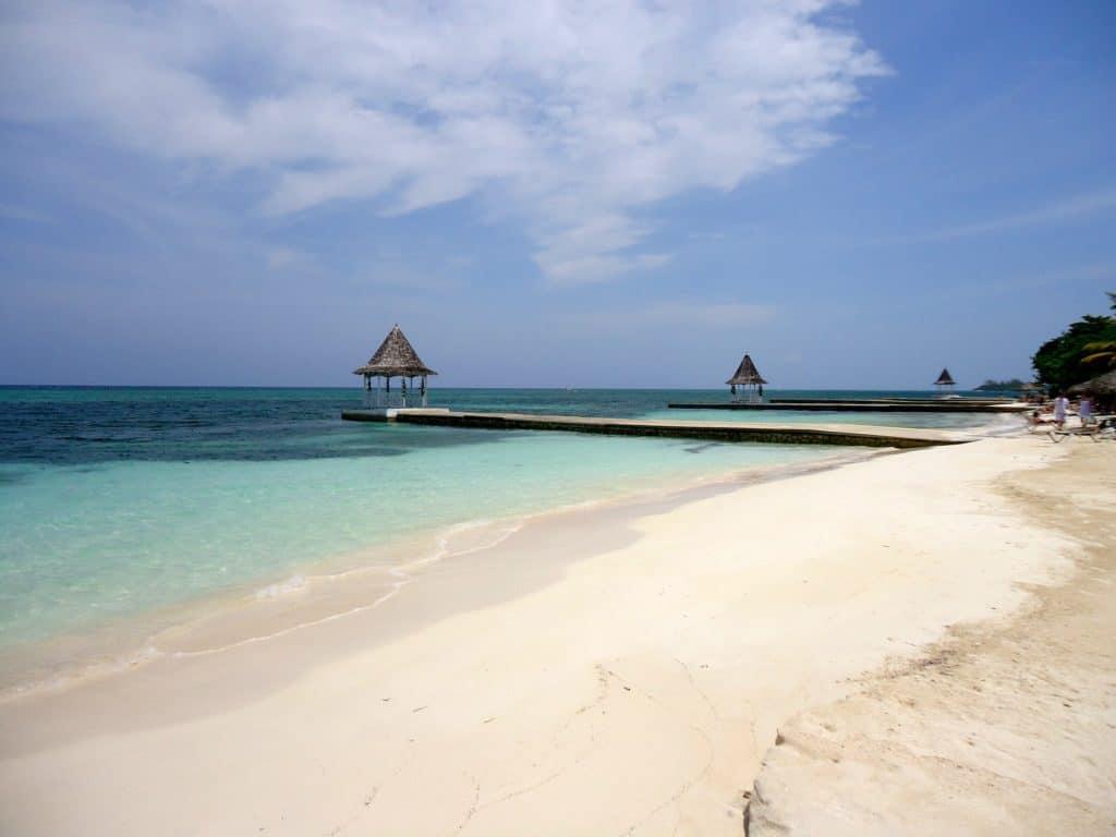 Tropical Island beach pier with a gazebo in the Caribbean Sea, Jamaica