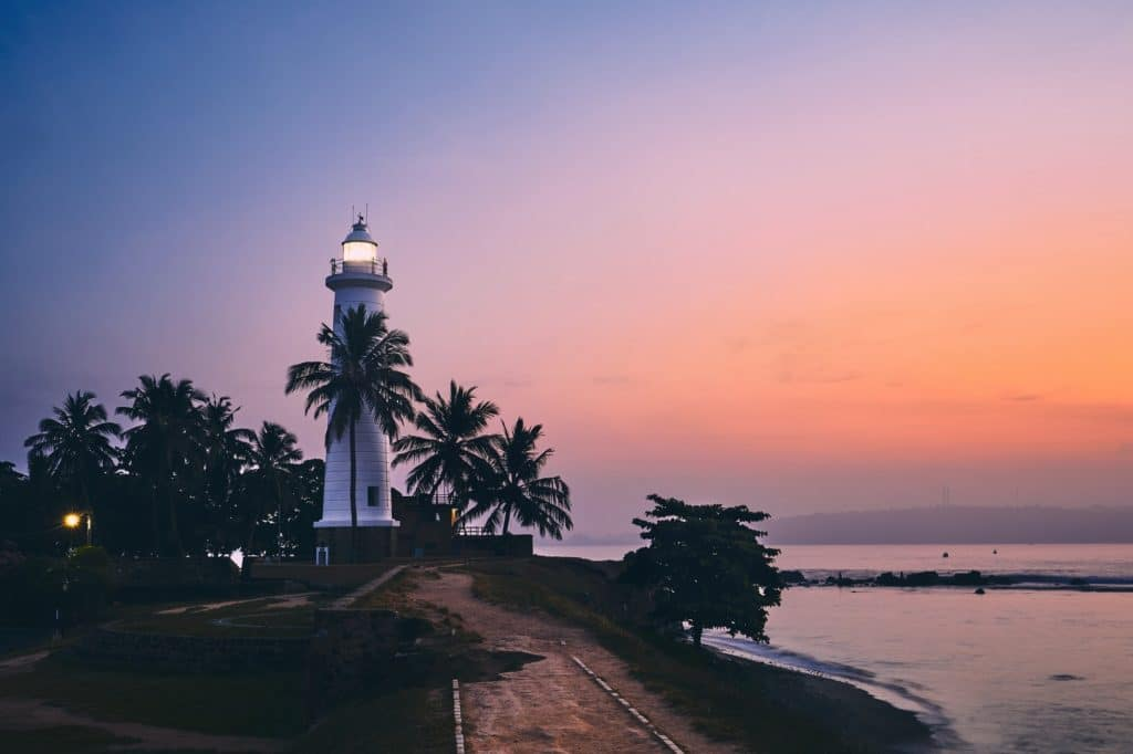 Lighthouse in fort in Galle. Old town in Sri Lanka at colorful sunrise.